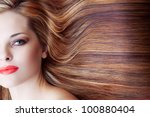 beautiful woman with artistic makeup and long brown shiny hair background - stock photo