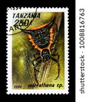 Small photo of MOSCOW, RUSSIA - JANUARY 2, 2018: A stamp printed in Tanzania shows Woodland Orb-Weaver (Micrathena sp.), Arachnids serie, circa 1994