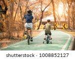 family bike on the park morning ... | Shutterstock . vector #1008852127