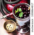 Small photo of Arabic hookah with a taste of berry alcoholic beverage