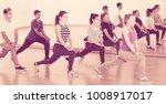 teenagers exercising in dance... | Shutterstock . vector #1008917017