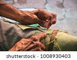 expert hands of a shoemaker | Shutterstock . vector #1008930403