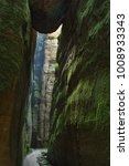 Small photo of Beautiful dark mysterious narrow chasm in nature with a ray of light