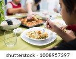 family gathering eating dinner...   Shutterstock . vector #1008957397