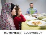 family gathering eating dinner...   Shutterstock . vector #1008958807