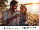 a young couple drinking... | Shutterstock . vector #1008992167