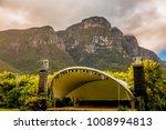 a concert venue below table... | Shutterstock . vector #1008994813