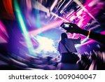 dj party at nightclub. girl... | Shutterstock . vector #1009040047