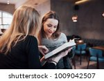 two young women sitting in the... | Shutterstock . vector #1009042507
