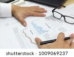 Small photo of Businessman Summary report and market plan analyzing money market plan,and Review accounting data.