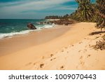 indian ocean coast with stones... | Shutterstock . vector #1009070443