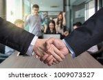 business shaking hands of... | Shutterstock . vector #1009073527