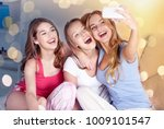 friendship  people  pajama... | Shutterstock . vector #1009101547