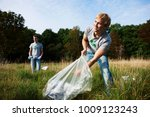 young man collecting trash in... | Shutterstock . vector #1009123243