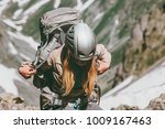 woman with backpack hiking in... | Shutterstock . vector #1009167463