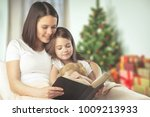 family mother and baby reading | Shutterstock . vector #1009213933