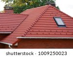 new red shingles roof with... | Shutterstock . vector #1009250023
