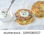 portion of zucchini fritters...   Shutterstock . vector #1009280527