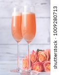 two glasses of bellini cocktail ...   Shutterstock . vector #1009280713