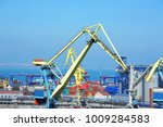 port cargo crane and container  ... | Shutterstock . vector #1009284583