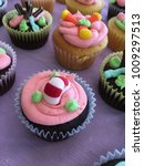 Small photo of Colorful whimsical home made cupcakes