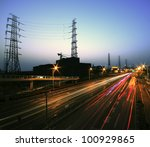 View long exposure photographs of urban night dusk Highway Traffic and transmission tower - stock photo