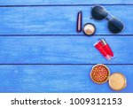 makeup products on blue wood... | Shutterstock . vector #1009312153