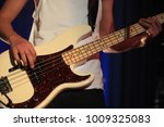 a person playing a guitar  | Shutterstock . vector #1009325083