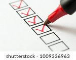 checklist marked red with a red ... | Shutterstock . vector #1009336963