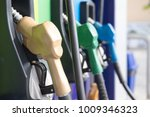 petrol pump filling nozzles in... | Shutterstock . vector #1009346323