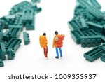 miniature 2 people stand on the ... | Shutterstock . vector #1009353937