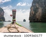 long boat and tropical beach ... | Shutterstock . vector #1009360177