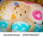 teddy bear sick in bed with... | Shutterstock . vector #1009360267