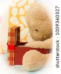teddy bear just received a gift ... | Shutterstock . vector #1009360327