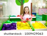 child playing in toy shop or... | Shutterstock . vector #1009429063