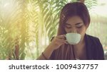 young businesswoman sitting and ... | Shutterstock . vector #1009437757