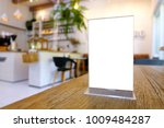 mock up menu frame standing on... | Shutterstock . vector #1009484287