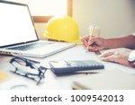team of engineers working...   Shutterstock . vector #1009542013