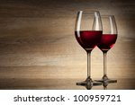 two Wine glases on a wooden Background - stock photo