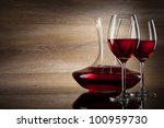 two Wine glass and decanter on a wooden Background - stock photo