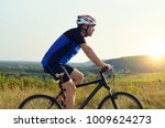 male cyclist driving by rural... | Shutterstock . vector #1009624273