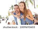 portrait of happy couple on... | Shutterstock . vector #1009693603