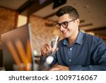 smiling caucasian man with... | Shutterstock . vector #1009716067