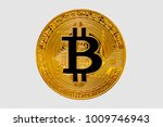 gold bitcoin coin closeup on... | Shutterstock . vector #1009746943