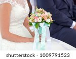 colorful bouquet in hands of... | Shutterstock . vector #1009791523