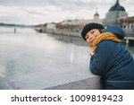Small photo of Little kid tourist admiring Rhone river from Bonaparte Bridge, Lyon, France. Travel with children.
