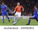 BERN, SWITZERLAND - JUNE 13:  Dirk Kuyt of the Netherlands passes the ball during a UEFA Euro 2008 match against France June 13, 2008 in Bern, Switzerland. Editorial use only. - stock photo