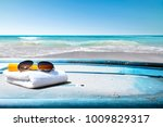 surfboard and summer time on... | Shutterstock . vector #1009829317