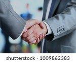 business people shaking hands... | Shutterstock . vector #1009862383