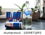 Small photo of Hamburg, Germany 01.25.2018 illustrative editorial of bottle of Absolut Vodka and cans of Red Bull energy drink on kitchen counter